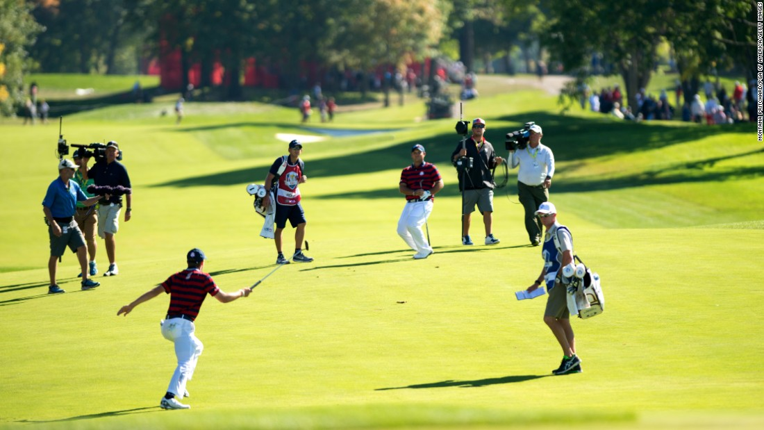 Jordan Spieth and Patrick Reed of the United States celebrate Patrick's shot on the sixth hole during the fourball matches for the 41st Ryder Cup at Hazeltine National Golf Course on October 1.