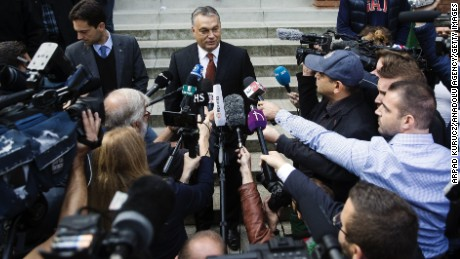 Hungarian Prime Minister Viktor Orban speaks to media after casting his vote.