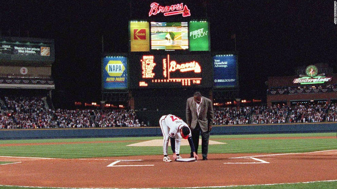 Former Atlanta Braves great Hank Aaron looks on as pitcher Tom Glavine puts home plate from Atlanta Fulton County Stadium on top of the plate at Turner Field before the Braves opened their new home against the Chicago Cubs on Friday, April 4, 1997.