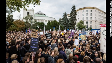 People attend the anti-government, pro-abortion demonstration in front of Polish Pariament in Warsaw, Poland on October 3, 2016.