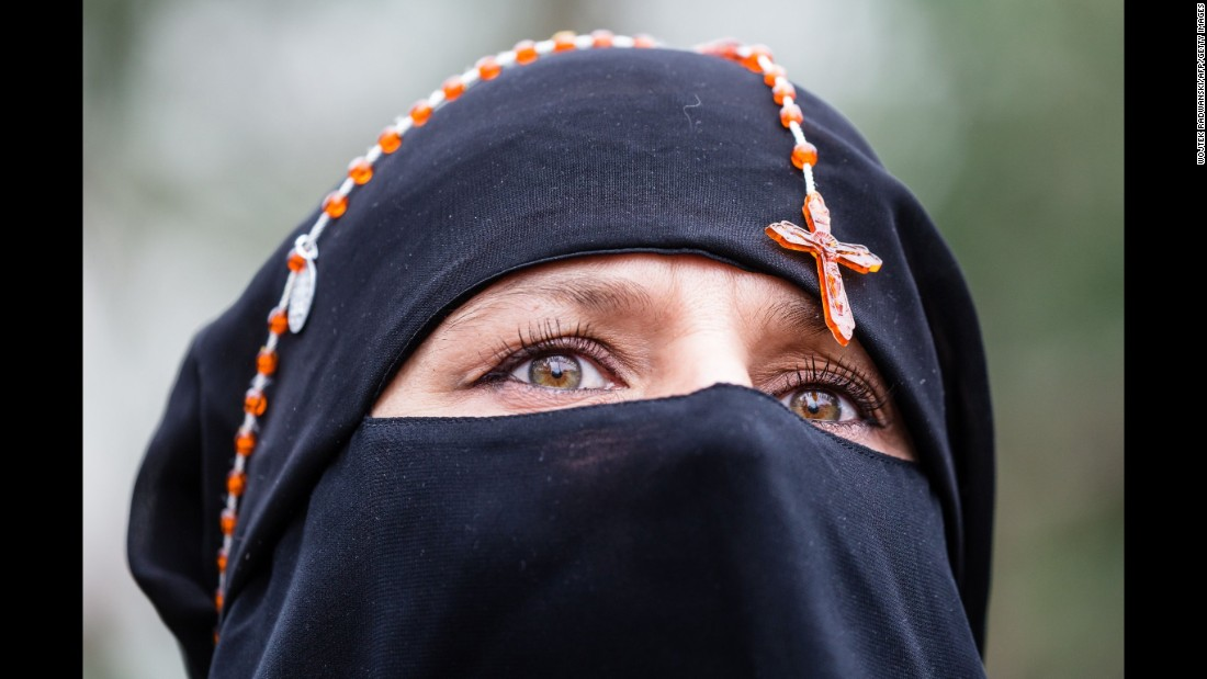 A woman with rosary beads around her head attends an earlier pro-choice demonstration in front of the Polish parliament in Warsaw, Poland on Saturday.