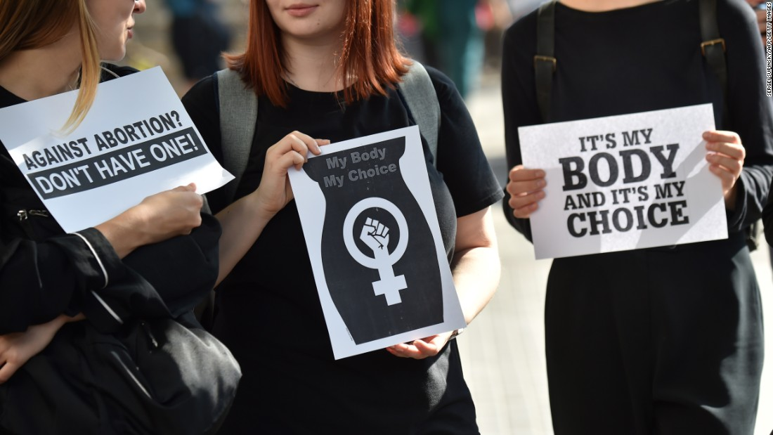 Women protest on Monday in Warsaw. Many were dressed in black.