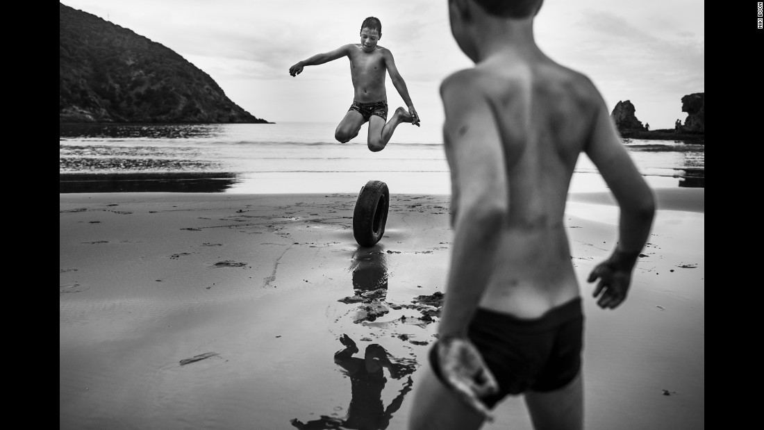 Two boys play on a beach in rural New Zealand. Niki Boon has been photographing her four home-schooled children as they explore the family's 10-acre property in Blenheim, on the northeastern tip of the country's South Island.