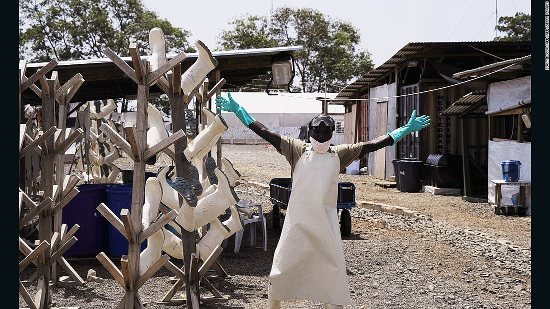 "There were celebrations when the West African Ebola epidemic was declared ""no longer an emergency"" in March 2016. But while the outbreak is over, Ebola is is still out there. Pictured, a Liberian worker dismantling shelters in a treatment center in March 2015."