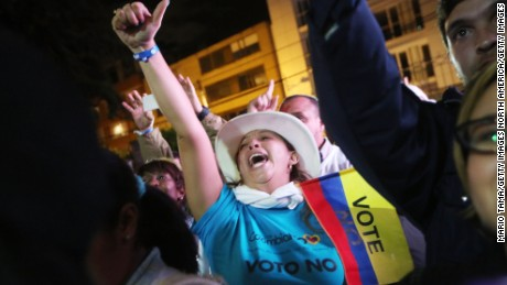 BOGOTA, COLOMBIA - OCTOBER 02:  'No' supporters celebrate at a rally following their victory in the referendum on a peace accord to end the 52-year-old guerrilla war between the FARC and the state on October 2, 2016 in Bogota, Colombia. The guerrilla war is the longest-running armed conflict in the Americas and has left 220,000 dead. The plan called for a disarmament and re-integration of most of the estimated 7,000 FARC fighters. Colombians have voted to reject the peace deal in a very close vote.  (Photo by Mario Tama/Getty Images)