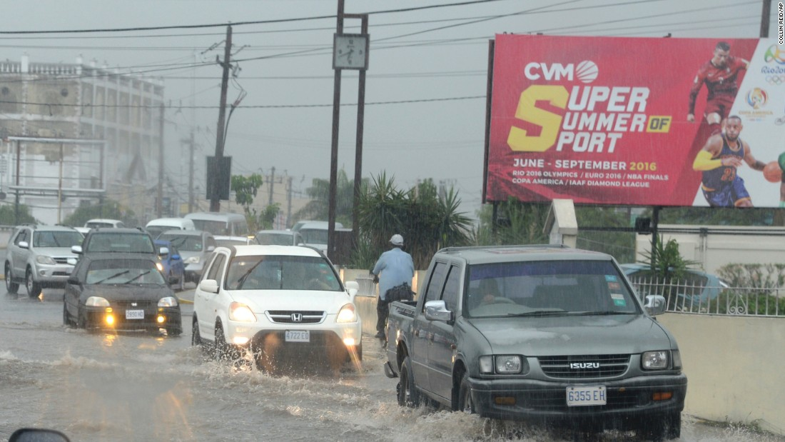 Motorists drive through heavy rains in Kingston, Jamaica, on October 2.