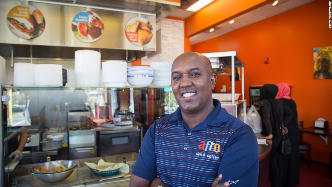 "Abdirahman Kahin, owner of Afro Deli restaurant in Minneapolis. Came to the U.S. from Somalia in the 1990s. Leans Democrat and is supporting Hillary Clinton. <br /><br />""We feel like we're double victims because number one, because as Americans we been affected by what happened, 9/11 because what these guys did. This affected me as an American. At the same time, other Americans see us as traitors."""