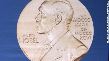 The laureate medal featuring the profile of Alfred Nobel.