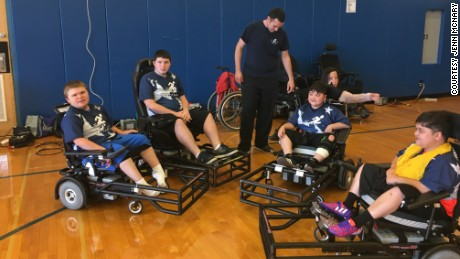 Austin, left, with his power soccer team.