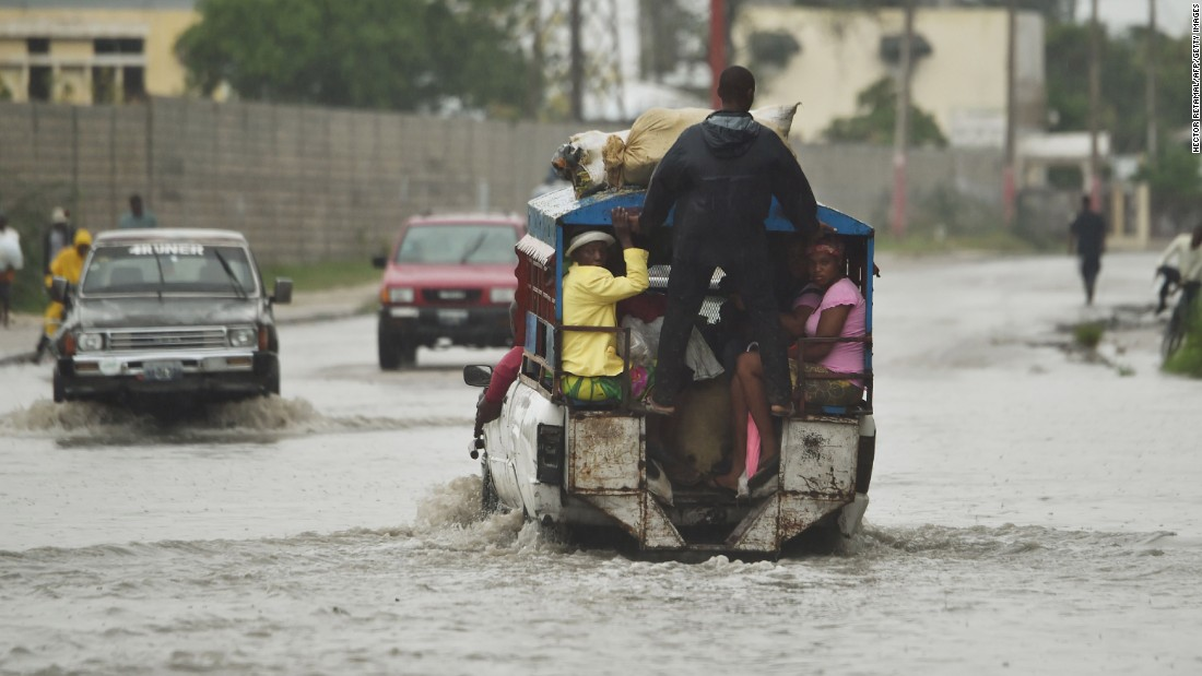 A truck used as public transportation drives through flooded streets in Port-au-Prince on October 4.