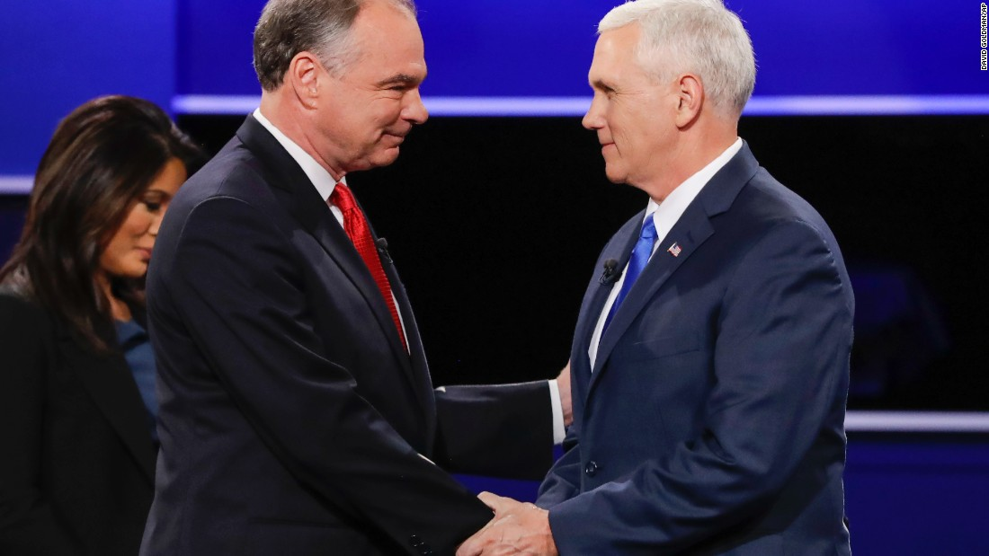 The two vice presidential candidates shake hands before the start of the debate.