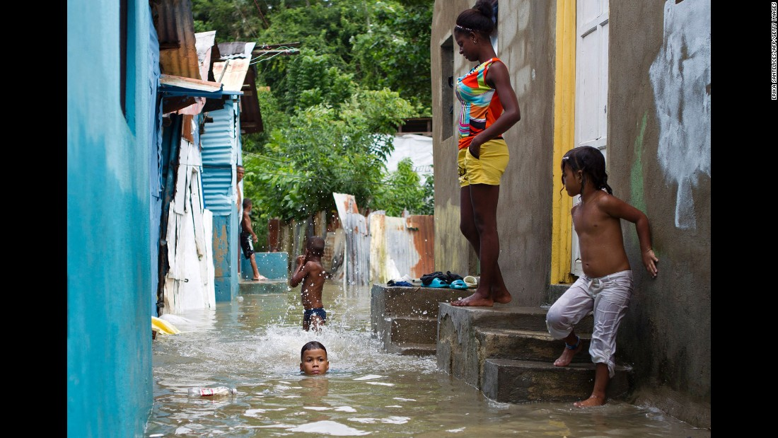 Children swim in a flooded neighborhood of Santo Domingo on October 4.