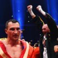 Tyson Fury celebrates as he defeats Wladimir Klitschko