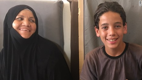 Amjad, the Darayya librarian, taught his mother (left) to read