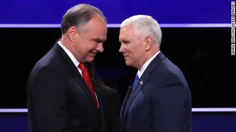 Democratic vice presidential nominee Tim Kaine (L) and Republican vice presidential nominee Mike Pence (R) meet on stage following the Vice Presidential Debate at Longwood University on October 4, 2016 in Farmville, Virginia.