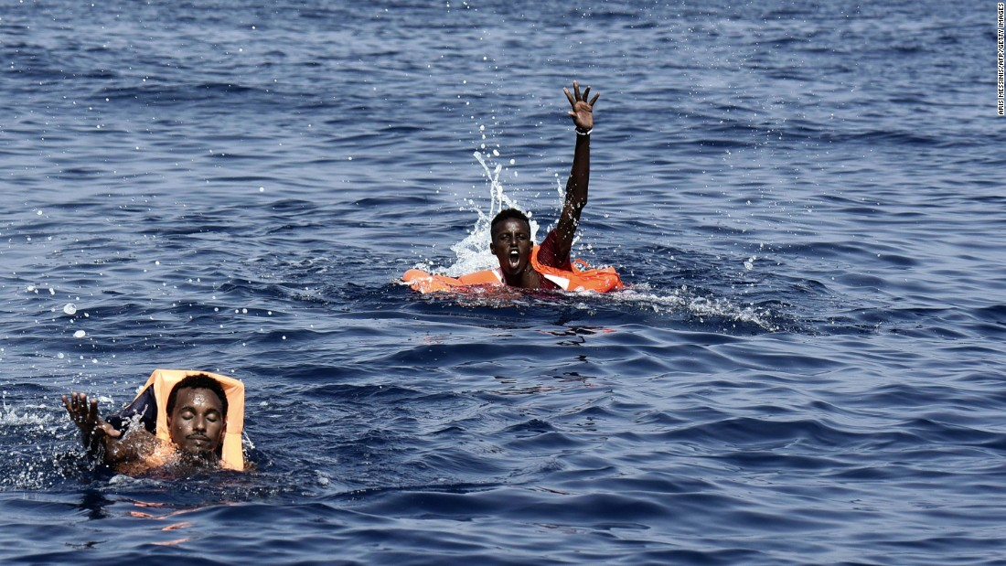 Migrants swim toward a rescue boat manned by the Spanish NGO Proactiva Open Arms in the Mediterranean Sea off the coast of Libya on Tuesday, October 4.