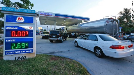 Drivers wait as a truck fills the empty tanks of a Marathon gasoline station, Wednesday, Oct. 5, 2016, in Hollywood, Fla. Hurricane Matthew marched toward Florida, Georgia and the Carolinas and nearly 2 million people along the coast were urged to evacuate their homes Wednesday, a mass exodus ahead of a major storm packing power the U.S. hasn't seen in more than a decade. (AP Photo/Wilfredo Lee)