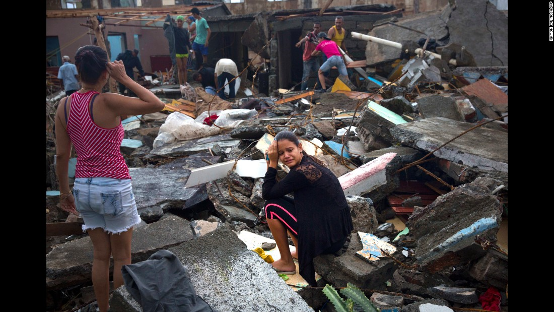 "A woman cries amid the rubble of her home in Baracoa, Cuba, on Wednesday, October 5. <a href=""http://www.cnn.com/2016/10/03/world/gallery/hurricane-matthew/index.html"" target=""_blank"">Hurricane Matthew</a> rolled across the sparsely populated tip of Cuba, destroying dozens of homes in the country's easternmost city."