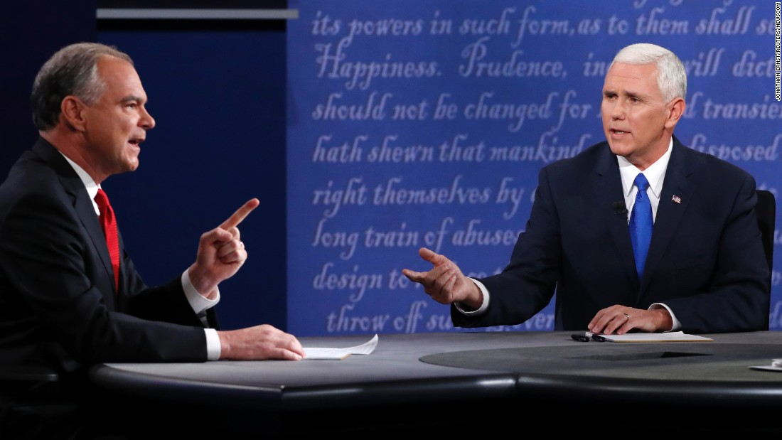 "U.S. Sen. Tim Kaine, left, discusses an issue with Indiana Gov. Mike Pence during <a href=""http://www.cnn.com/2016/10/04/politics/gallery/vice-presidential-debate/index.html"" target=""_blank"">the vice presidential debate</a> on Tuesday, October 4. Kaine is the running mate to Democratic nominee Hillary Clinton. Pence is on the ticket with Republican nominee Donald Trump. <a href=""http://www.cnn.com/2016/10/05/opinions/pence-kaine-debate-reaction-roundup/"" target=""_blank"">Opinions: Who won the debate?</a>"