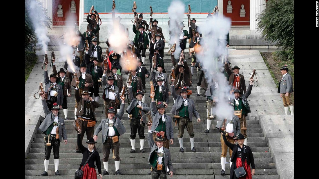 "Men and women in traditional Bavarian costumes fire muzzleloaders Monday, October 3, on the last day of the Oktoberfest beer festival in Munich, Germany. <a href=""http://www.cnn.com/2016/09/21/world/gallery/tbt-oktoberfest/index.html"" target=""_blank"">#tbt: Lighthearted moments from old Oktoberfests</a>"