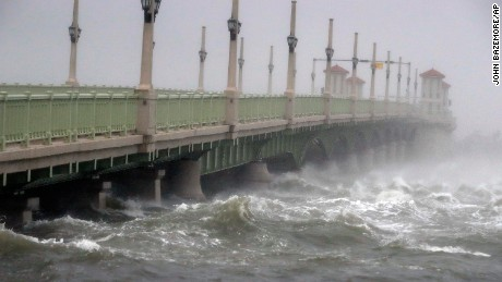 Waves crash against a bridge in St. Augustine, Florida, on Friday, October 7.