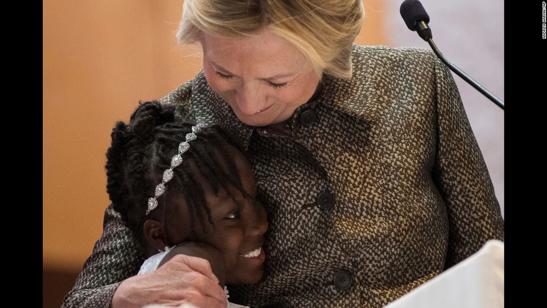 "Democratic presidential candidate Hillary Clinton hugs Zianna Oliphant on stage <a href=""http://www.cnn.com/2016/10/02/politics/hillary-clinton-zianna-oliphant-keith-lamont-scott-charlotte/"" target=""_blank"">after speaking at a church</a> in Charlotte, North Carolina, on Sunday, October 2. Zianna, 9, garnered national attention when she tearfully spoke at a Charlotte City Council meeting about recent police killings of African-Americans. Clinton told the congregation she ""wouldn't be able to stand it"" if her own grandchildren ever felt the kind of fear and worry that Oliphant and others have expressed."