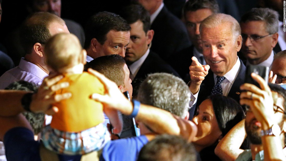 Vice President Joe Biden points at an 8-month-old boy during a Hillary Clinton rally in Orlando on Monday, October 3.
