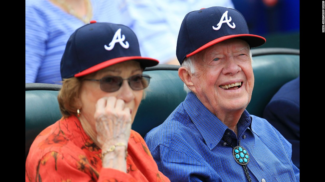 Former US President Jimmy Carter sits in the stands for an Atlanta Braves baseball game on Sunday, October 2.