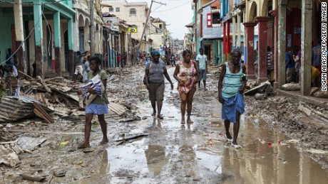 People walk through their destroyed town of Jeremie, Haiti on Thursday October 6.