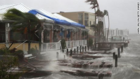 Heavy waves pound boat docks at the Sunset Bar and Grill.
