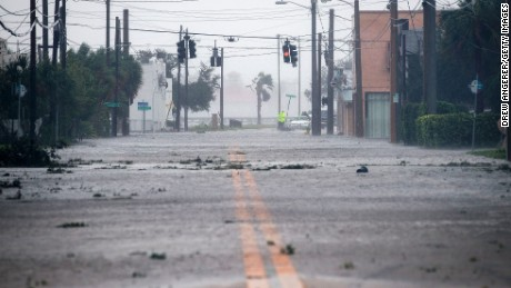 Water covers a road leading toward the Halifax River and Daytona Beach after Hurricane Matthew passes through on October 7 in Daytona Beach, Florida.
