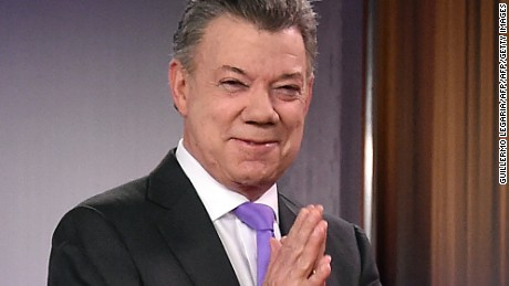 Colombian president Juan Manuel Santos gestures before a press conference after winning the Nobel Peace Prize 2016 on October 7, 2016 at Casa de Narino presidential palace in Bogota. Colombia's President Juan Manuel Santos dedicated his Nobel Peace Prize Friday to the victims of his country's civil war, which he has worked to end through a contested peace accord with communist rebels / AFP / GUILLERMO LEGARIA        (Photo credit should read GUILLERMO LEGARIA/AFP/Getty Images)
