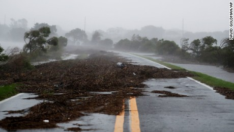 Debris litters a road after it washed over from Hurricane Matthew on St. Simons Island, Ga.