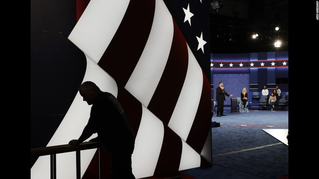 Students stand in on the stage as preparations are made for the second presidential debate between Republican presidential nominee Donald Trump and Democratic presidential nominee Hillary Clinton at Washington University in St. Louis on Saturday, October 8. The debate is set to air Sunday, October 9.