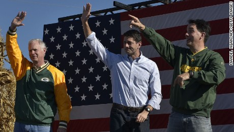 From left: Senator Ron Johnson, R-WI, House Speaker Paul Ryan, R-WI, and Wisconsin Governor Scott Walker wave at the end of the 1st Congressional District Republican Party of Wisconsin Fall Fest on October 8, 2016 at the Walworth County Fairgrounds in Elkhorn, Wisconsin.