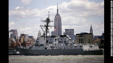 NEW YORK - MAY 24:  The USS Mason sails down the Hudson River past the Empire State building May 24, 2006 in New York City. Sailors, Marines, and Coast Guardsmen will sail into New York during the Parade of Ships May 23 that begins the annual Fleet Week.