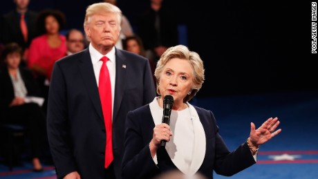 ST LOUIS, MO - OCTOBER 09:  Democratic presidential nominee former Secretary of State Hillary Clinton (R) speaks as Republican presidential nominee Donald Trump looks on during the town hall debate at Washington University on October 9, 2016 in St Louis, Missouri. This is the second of three presidential debates scheduled prior to the November 8th election.  (Photo by Rick Wilking-Pool/Getty Images)