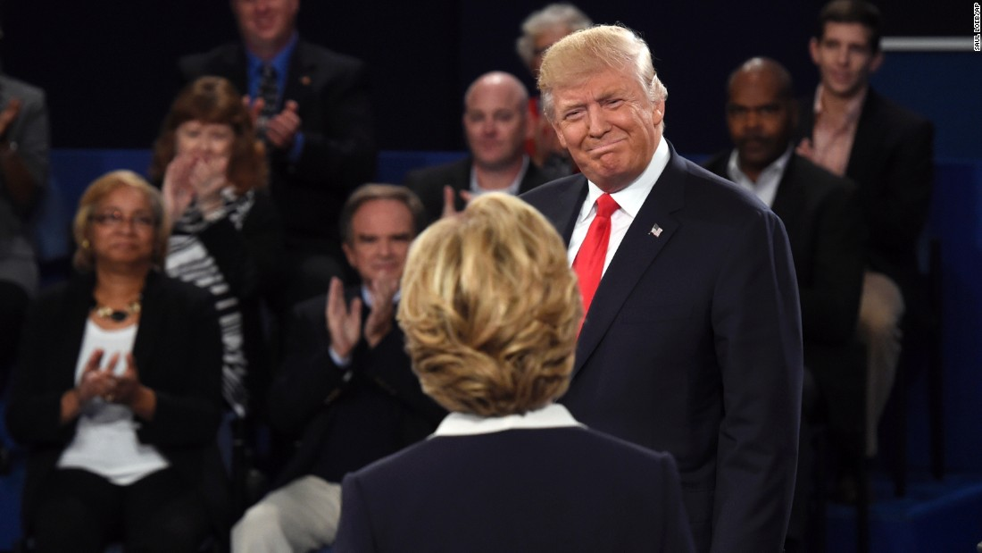 Trump greets Clinton before the start of the debate.