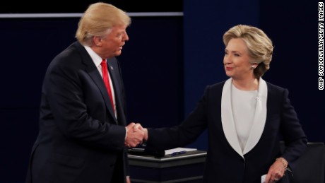 ST LOUIS, MO - OCTOBER 09:  Republican presidential nominee Donald Trump shakes hands with Democratic presidential nominee former Secretary of State Hillary Clinton during the town hall debate at Washington University on October 9, 2016 in St Louis, Missouri. This is the second of three presidential debates scheduled prior to the November 8th election.  (Photo by Chip Somodevilla/Getty Images)