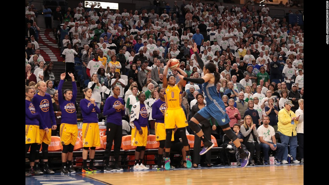 Los Angeles' Alana Beard shoots a buzzer-beater to win Game 1 of the WNBA Finals on Sunday, October 9. Beard's corner shot broke a 76-76 tie as time expired in Minneapolis.