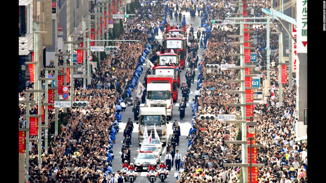 A parade is held in downtown Tokyo on Friday, October 7, for Japanese athletes who medaled at the Olympics and the Paralympics.