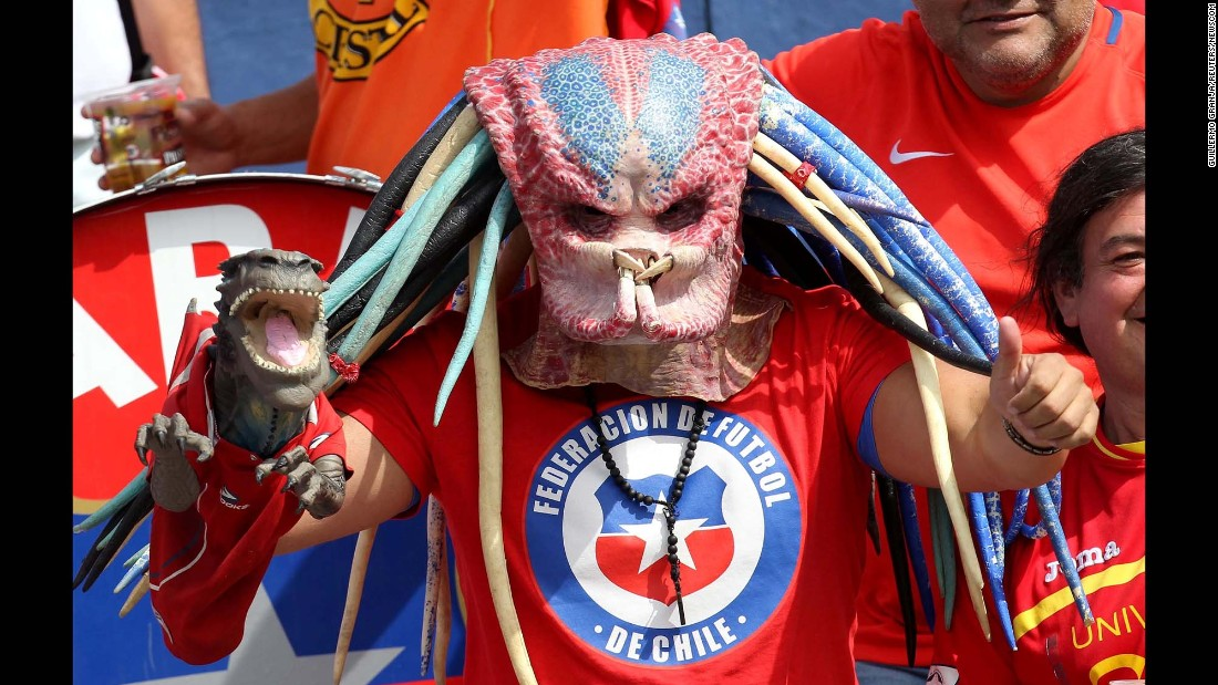 "A Chile fan wears a ""Predator"" mask during a World Cup qualifier in Quito, Ecuador, on Thursday, October 6."
