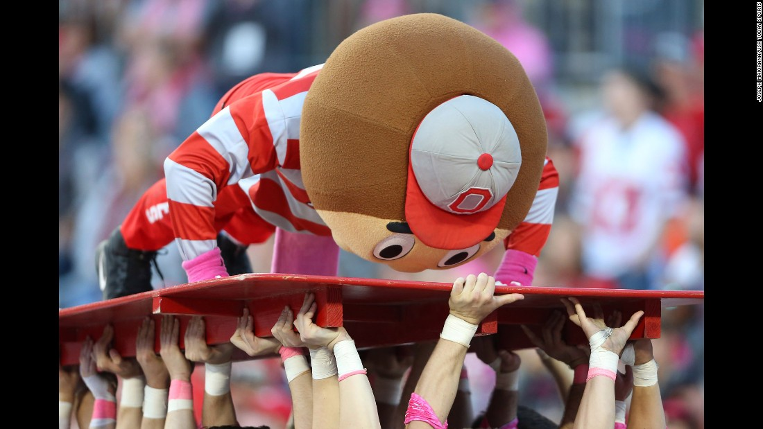 Brutus Buckeye does pushups during Ohio State's home game against Indiana on Saturday, October 8.