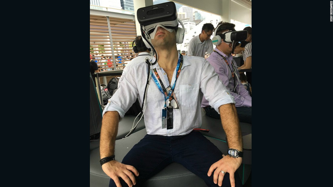 A Formula E fan tries out the latest Virtual Reality technology at the Jaguar entertainment stand.