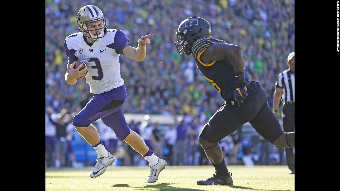Washington quarterback Jake Browning points at an Oregon defender as he walks into the end zone on Saturday, October 8. Browning received a penalty for unsportsmanlike conduct, but he piled up eight touchdowns on the day as the Huskies pounded their rival 70-21.