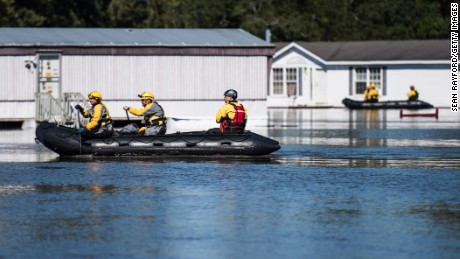 Rescue teams maneuver through floodwaters Monday in Lumberton, North Carolina.