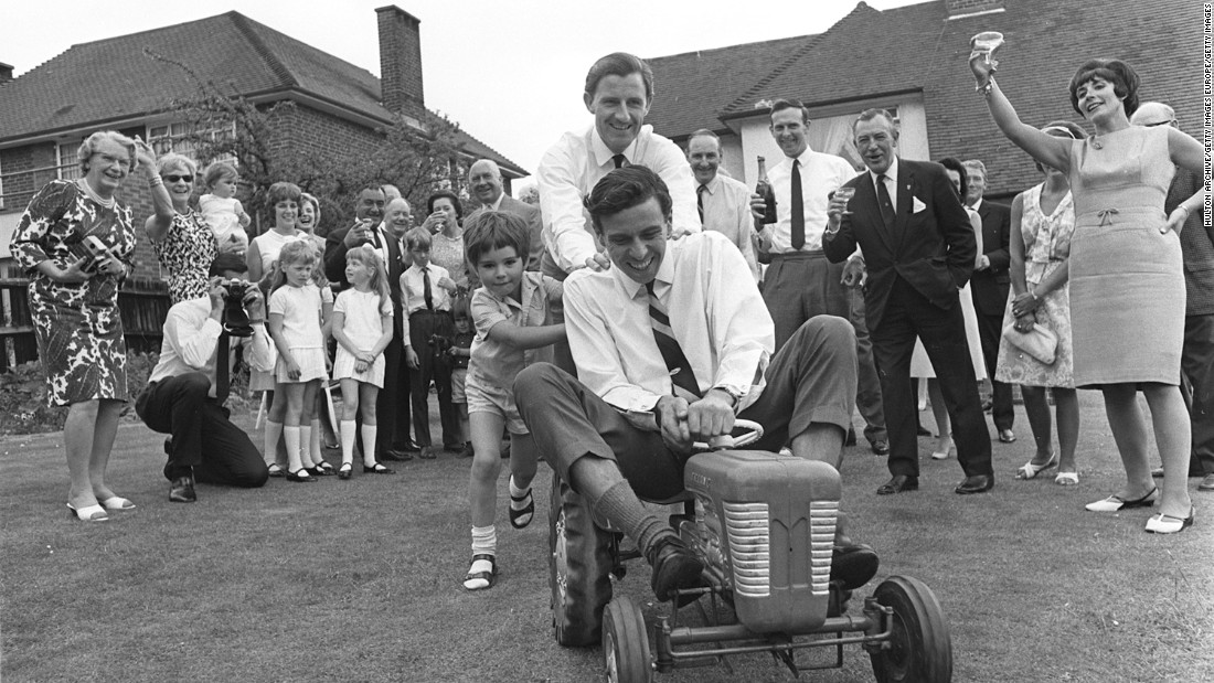 Graham and Damon Hill are the only father-son world champions in F1. Graham (center) is pictured with Damon pushing reigning world champion Jim Clark around on a toy tractor in 1966.