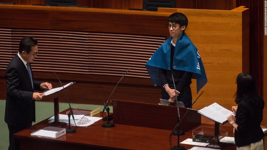 "Lawmakers not only displayed flags declaring that Hong Kong is not a part of China but also called out for ""democratic self-determination"" for the semi-autonomous Chinese city at Wednesday's oath taking session."