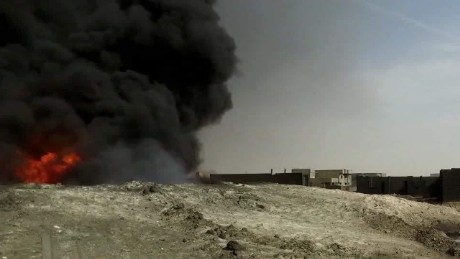 ISIS sets oil wells on fire