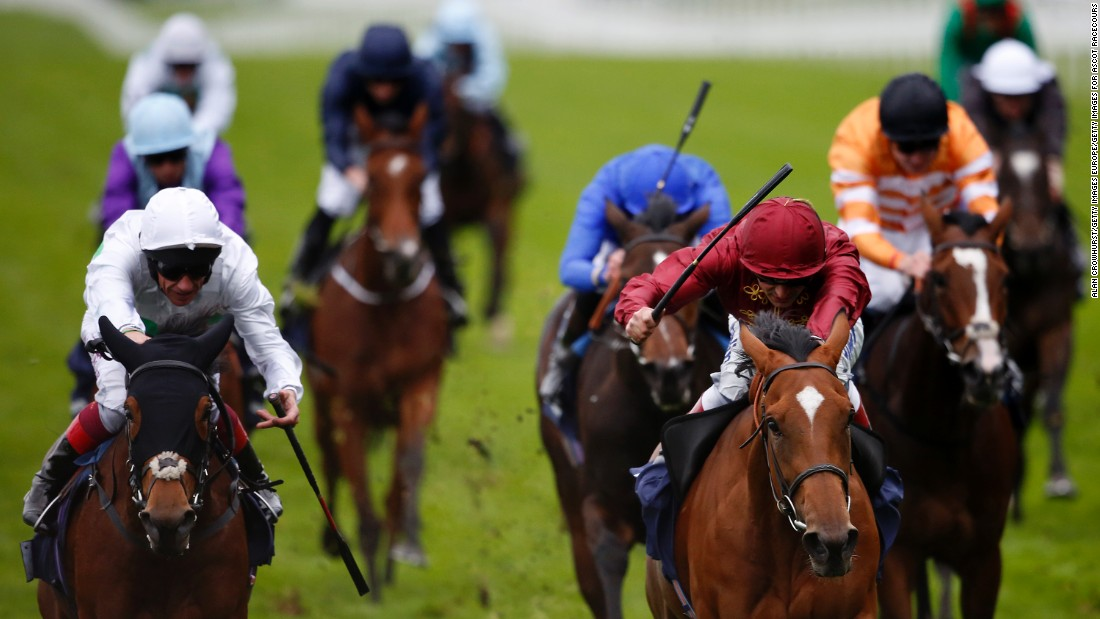 Andrea Atzeni rides Simple Verse (right, maroon colors) to victory in the 2015 British Champions Fillies and Mares Stakes.